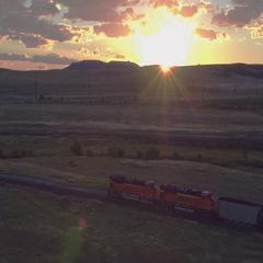 Sunrise over coal train Stock Footage