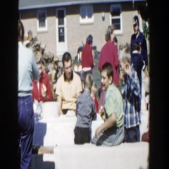 1958: the whole family sits down for lunch in the back yard WISCONSIN Stock Footage
