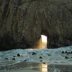 Waves crashing through Keyhole Arch at Pfeiffer Beach in California Stock Footage