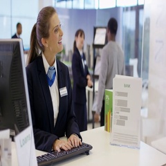 4K Bank worker at service desk assists customer with a cash withdrawal Stock Footage