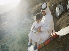 Arab man with son using digital tablet. Stock Footage