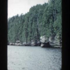 1964: water scene trees alongside beautiful scene WISCONSIN Stock Footage