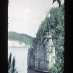 1964: water area boat loading people trees alongside WISCONSIN Stock Footage