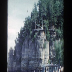 1964: cliff with a view of the water and the surrounding land  Stock Footage