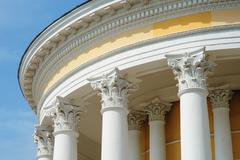 White columns on the facade of architectural buildings Stock Photos