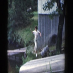 1964: woman walking holding a fishing pole WISCONSIN Stock Footage