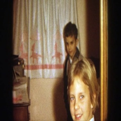 1964: two children are looking at a lens while taking a special moment WISCONSIN Stock Footage