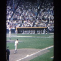 1964: crowd watching a baseball game, where a pitcher throws the ball  Stock Footage