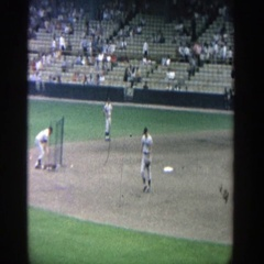 1964: as the pitcher practices his pitch, the batter is preparing  Stock Footage
