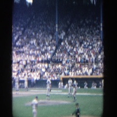 1964: baseball players approach pitcher on mound and relief pitcher removes Stock Footage