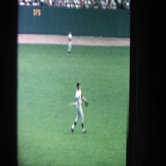 1964: baseball player throwing a ball in a field with green grass YANKEE STADIUM Arkistovideo