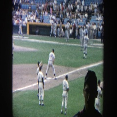 1964: a view of baseball players warming up for a game on a sunny day Stock Footage