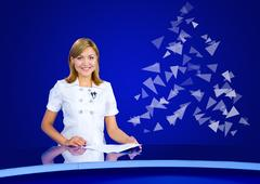 Television anchorwoman at empty blue studio with Christmas tree Kuvituskuvat