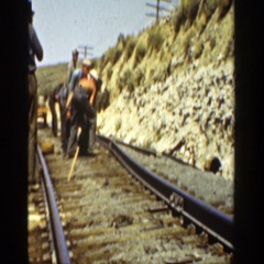 1936: a group of workers displacing the rail track CALIFORNIA Stock Footage