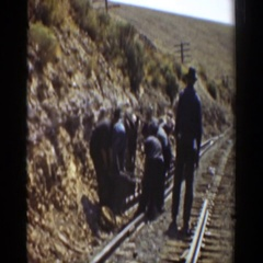 1936: railroad workers making repairs to a train track in the countryside Stock Footage