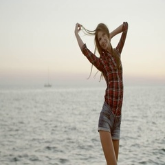 Woman with beautiful figure posing at a sea background Stock Footage