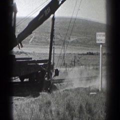 1936: an earth mover is working in a vast arid land with grasses CALIFORNIA Stock Footage