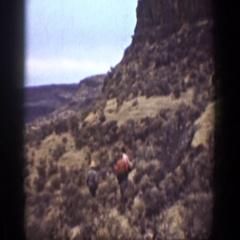 1936: random people hiking in a far away desert. CALIFORNIA Stock Footage
