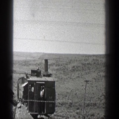 1936: earth remover is working on the arid vast land CALIFORNIA Stock Footage