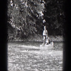 1939: people standing in the water having fun and enjoying each others time Stock Footage
