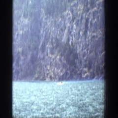 1939: enjoying a lovely afternoon sailing in a boat. CHELAN WASHINGTON Stock Footage