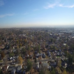A low-level aerial view of a large residential area in the fall COLORADO Stock Footage