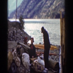1939: people sitting by a body of water drinking and having a great time CHELAN Stock Footage