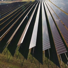 Long rows of photovoltaic panels at a solar farm Stock Footage