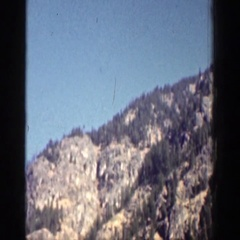 1939: two boats float in a lake in a valley on a clear day CHELAN WASHINGTON Stock Footage