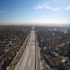 View from above of vehicles racing up and down the freeway COLORADO Stock Footage