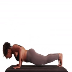 Isolated mixed race millennial woman doing yoga on matt Stock Footage
