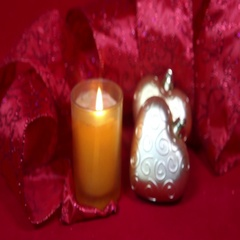 New Year's composition on a red background - ball and ribbon and a candle Stock Footage
