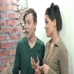 Man in pullover and woman depict eating something unusual. Casting. Brick wall Stock Footage