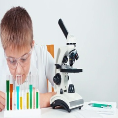 Close up portrait young chemist schoolboy mixing chemicals liquids in test tube Stock Footage