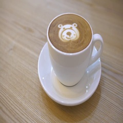 4K Female Hands Hold Cup Of Coffee with a face bear shape for breakfast.-Dan Stock Footage
