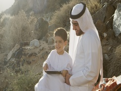 Arab man with son holding digital tablet. Stock Footage