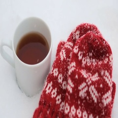 Red mittens and a mug of tea Stock Footage