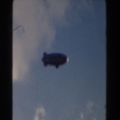 1960: a large goodyear blimp flying through the sky MIAMI, FLORIDA Stock Footage