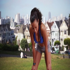 Mixed race woman runner taking a quick break then continues her run Stock Footage