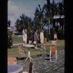 1961: two ladies walking across the backyard. NASSAU Stock Footage