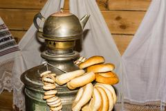 Old copper samovar and bagels. Stock Photos