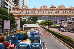 Tourists move by a KL Hop On Hop Off bus Stock Photos