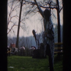 1961: a woman holding a fish on a line above the grass NOVI MICHIGAN Stock Footage