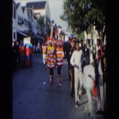 1961: group of people in interesting outfits running down the road  Stock Footage