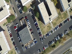 A birds eye view of a group of building roofs and parking lot COLORADO Stock Footage