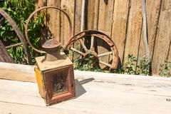 Antique lantern, covered with dust. Stock Photos