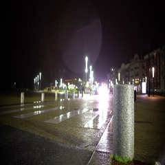 Car driving in the street at cold rainy evening, dazzling headlights. Urban life Stock Footage