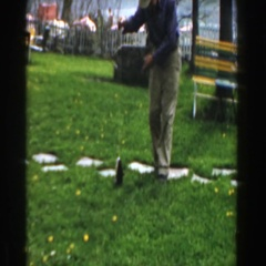 1961: man playing with his fish that he just recently caught. NOVI MICHIGAN Stock Footage