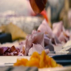Chefs hands at the kitchen laid out pieces of sliced ham, close up Stock Footage