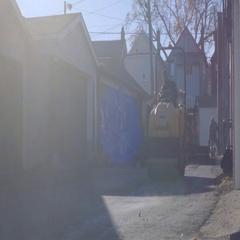 Steamroller flattens fresh asphalt Stock Footage